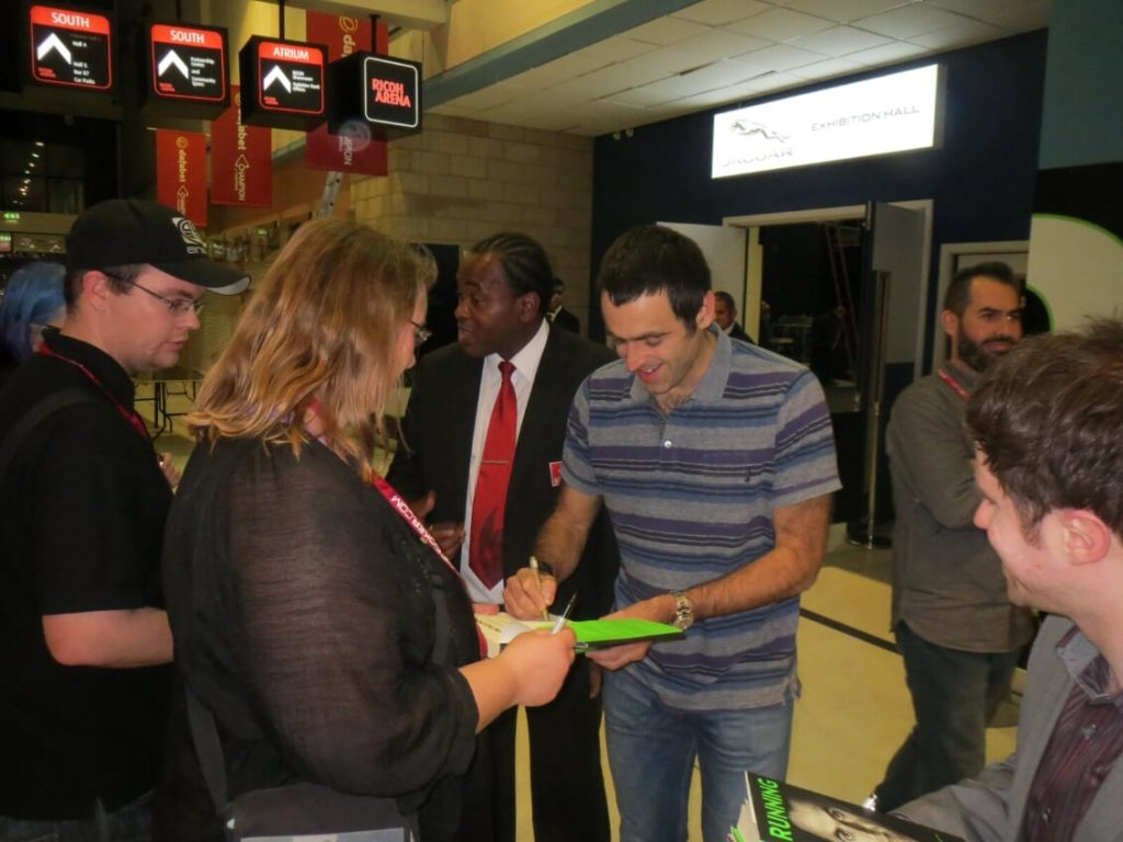 Picture of Ronnie OSullivan signing autographs after his win at the Champion of Champions 2014